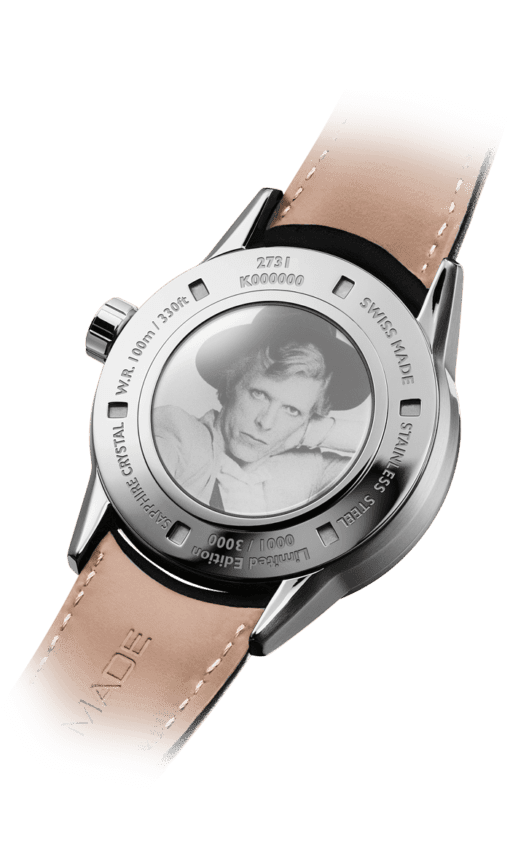 Back view of the David Bowie Automatic Watch with tan leather strap and Bowie image on the back