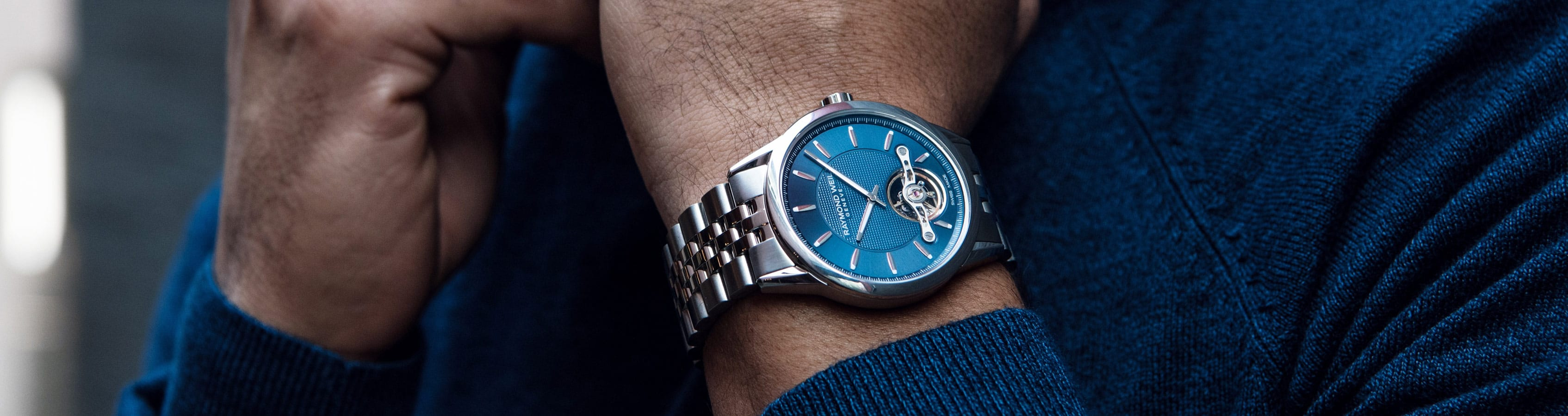 RAYMOND WEIL Blue Men's Freelancer Automatic Watch with a Visible Balance Wheel.